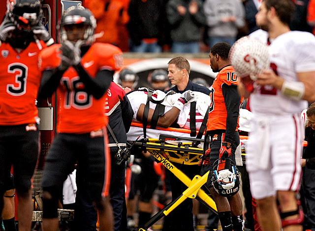 Stanford WR Chris Owusu is carted off the field after a helmet-to-helmet hit in November 2011. (Getty Images)