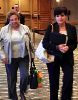 Donna Shalala, with Miami VP for communications Jacqueline Menendez, exits the infractions hearing. (Photo by Dennis Dodd)