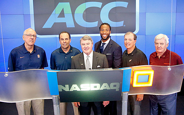 John Swofford, center, says ESPN had limited influence on the ACC's decision to add Pitt and Syracuse.(USATSI)
