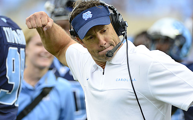 Larry Fedora says he uses the no-huddle offense to keep defenses honest, not rack up plays. (USATSI)