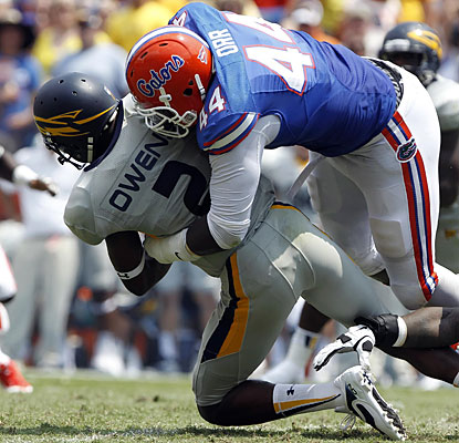 Florida's defense picked up where it left off last season, putting constant pressure on Toledo's offense.  (USATSI)