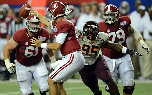 Behind a rebuilding offensive line, Alabama QB AJ McCarron struggles against Virginia Tech's pressure. (USATSI)