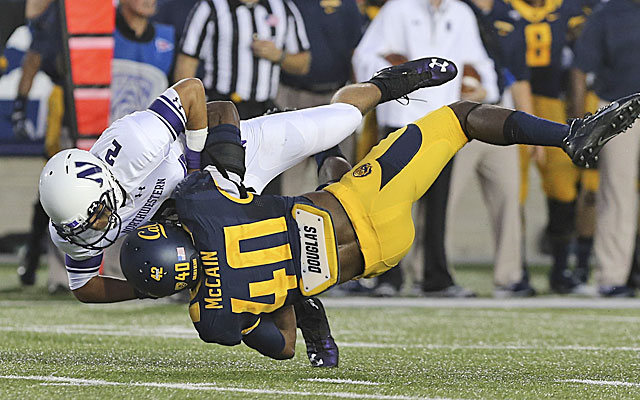 Cal's Chris McCain was ejected after this hit on Northwestern QB Kain Colter. (USATSI)