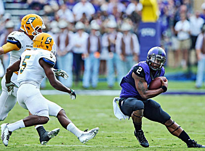 TCU's Trevone Boykin (right) tries to elude a pair of Southeastern Louisiana defenders after replacing Casey Pachall. (USATSI)