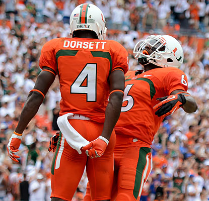 Phillip Dorsett celebrates his 52-yard score with Herb Waters, who recorded the Canes' first TD in a big start.  (USATSI)