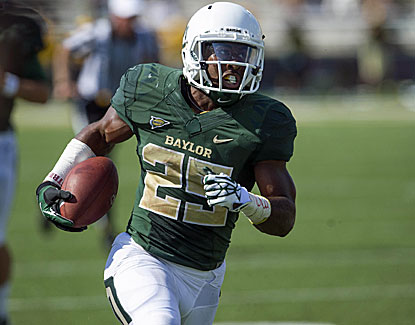 Baylor's Lache Seastrunk runs for 150 yards and three scores in Baylor's romp over Buffalo.  (USATSI)