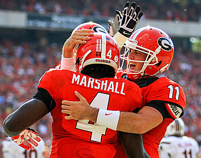 Aaron Murray hooks up with Keith Marshall for one of his four TD passes against South Carolina. (USATSI)