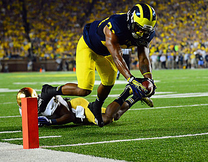 Michigan's Jeremy Gallon dives for the end zone for one of his three touchdowns in Michigan's win over Notre Dame. (USATSI)