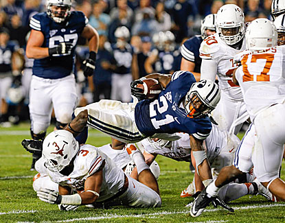 BYU does most of its damage on the ground, rushing for a school-record 550 yards to defeat Texas. (USATSI)