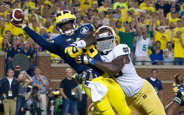 Devin Gardner tries to avoid a safety here, but instead he hands the Irish a touchdown. (USATSI)