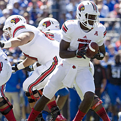 Louisville quarterback Teddy Bridgewater overcomes a shaky start to pass for 250 yards and a touchdown against rival Kentucky. (USATSI)