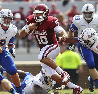 The Belldozer shows off his arm as Blake Bell puts up 413 passing yards and four TD throws in his first start.  (USATSI)
