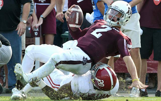 Johnny Manziel boosts his Heisman stock while Alabama notches another victory. (USATSI)