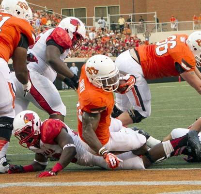 Jeremy Smith scores one of his three touchdowns to lead a 59-3 blowout of overmatched Lamar.   (USATSI)