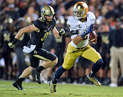 Notre Dame's Bennett Jackson returns an interception 34 yards to help the Irish preserve a win at Purdue. (USATSI)
