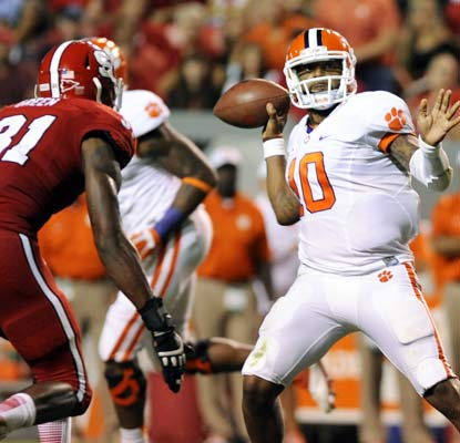 Tajh Boyd tallies three touchdown passes to guide the third-ranked Tigers to an important road win against the Wolfpack.  (USATSI)