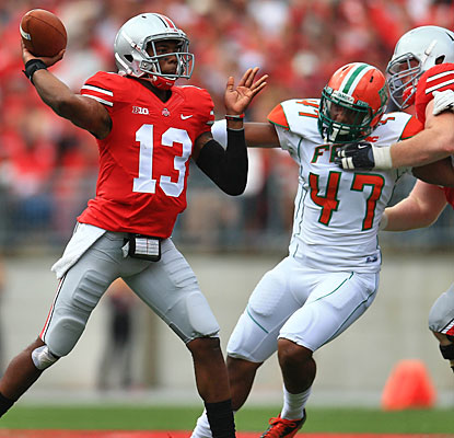 Kenny Guiton, starting for the injured Braxton Miller, enters the Ohio State record books with six first-half TD passes.  (USATSI)
