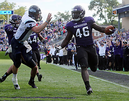 Northwestern linebacker Damien Proby returns an interception for a touchdown, one of two for the Wildcats. (USATSI)