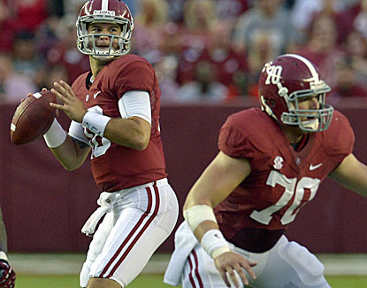 Alabama's AJ McCarron completes 20 of 26 passes but also is intercepted on an ill-advised throw. (USATSI)