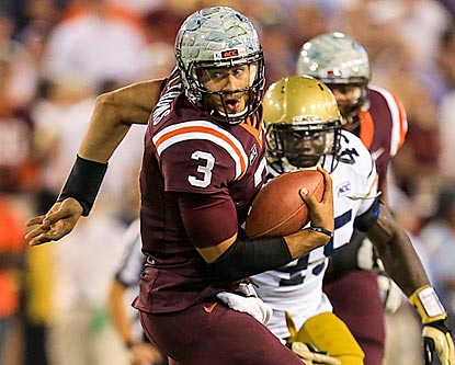 Logan Thomas, shown running during the second half, battles through an injury and leads the Hokies to a big road victory.  (USATSI)