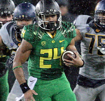 By the time Thomas Tyner races for a 21-yard touchdown, Oregon has already blown Cal out of the water.  (USATSI)