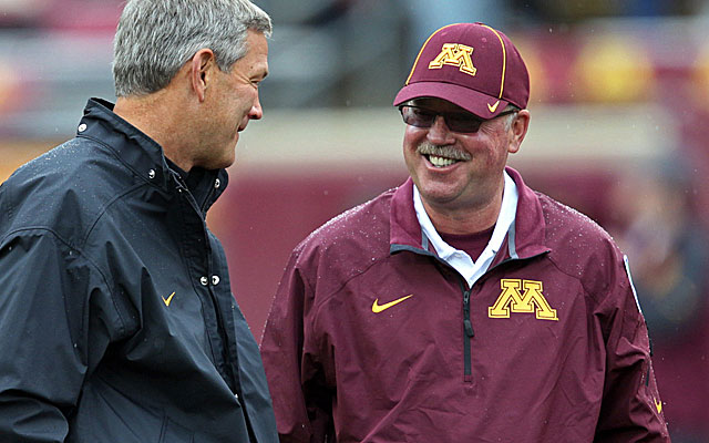 Jerry Kill, right, with Iowa coach Kirk Ferentz at last week's game. (USATSI)