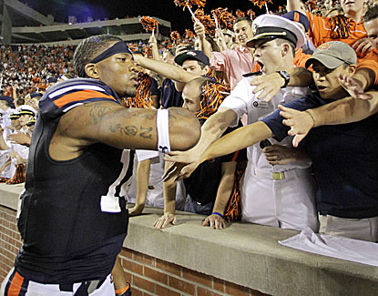 Nick Marshall celebrates with the Auburn fans after his two-touchdown game in the Tigers' victory over Ole Miss. (USATSI)