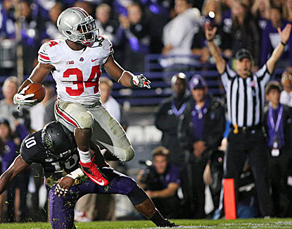 Ohio St. running back Carlos Hyde slips into the end zone for one of his three touchdowns in the Buckeyes' win at Northwestern. (USATSI)