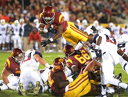 Southern California tailback Javorius Allen dives over the pile for a 1-yard touchdown in the second quarter.  (USATSI)