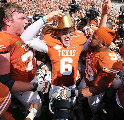 Texas celebrates after Case McCoy earns his first victory over Oklahoma; brother Colt went 3-1 vs. the Sooners.  (USATSI)