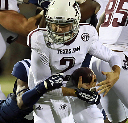 Johnny Manziel throws for 346 yards and runs for two touchdowns as Texas A&M escapes over Ole Miss. (USATSI)