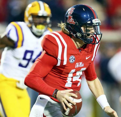 Ole Miss quarterback Bo Wallace racks up 346 yards through the air, completing 30 of 39 passes in a win over No. 6 LSU.  (USATSI)
