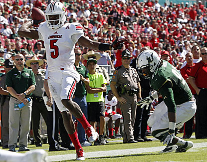 Louisville quarterback Teddy Bridgewater gets the Cardinals back on track, throwing for three scores in a rout of USF. (USATSI)