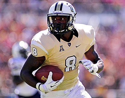 UCF running back Storm Johnson runs for one touchdown and catches another in the Knights' rout of Connecticut. (USATSI)
