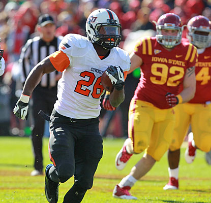 Desmond Roland does the heavy lifting on offense for Oklahoma State, rushing for 219 yards and four touchdowns.  (USATSI)