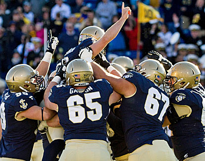Navy's Nick Sloan is at the top of the pile after booting the game-winning field goal against Pittsburgh. (USATSI)