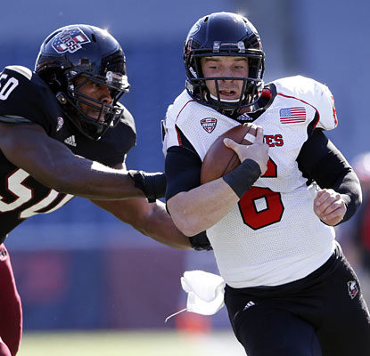 UMass has no answer for Jordan Lynch, who leads the way for NIU with 119 rushing yards and four TDs, plus one passing.  (USATSI)