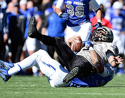 Air Force's Robert Green pulls down Army quarterback Angel Santiago in the Falcons' 42-28 win. (USATSI)