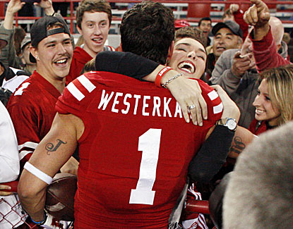 Nebraska's Jordan Westerkamp celebrates with fans after catching a deflected pass for a touchdown on the game's final play. (USATSI)