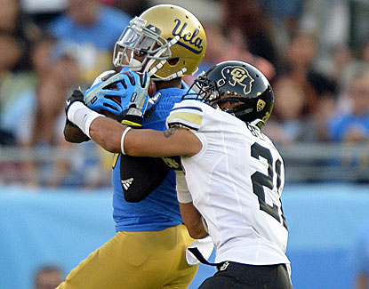 UCLA's Devin Fuller pulls down a touchdown pass over Colorado's Jered Bell for one of his three scores in a win over the Buffs. (USATSI)