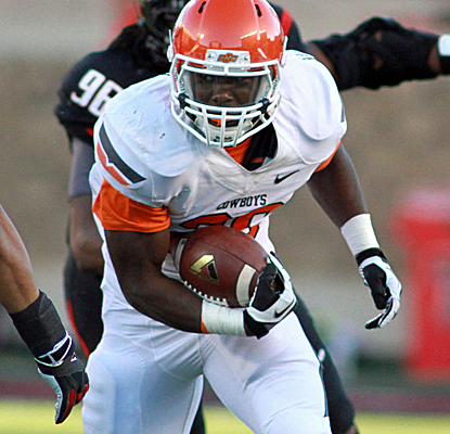 Oklahoma St. running back Desmond Roland scores three touchdowns, giving him seven TDs in the last two weeks.  (USATSI)