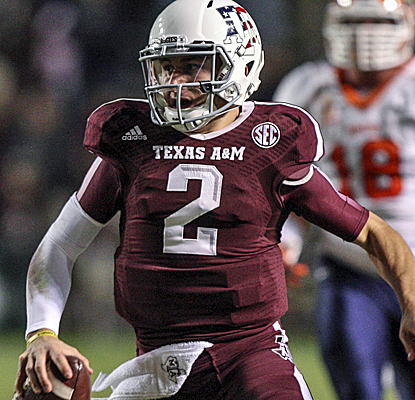 Johnny Manziel throws for four touchdowns and runs for another two as Texas A&M routs UTEP.  (USATSI)