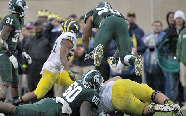 Michigan State stifles Michigan, which converts just 2 of 14 third-down conversions Saturday. (USATSI)