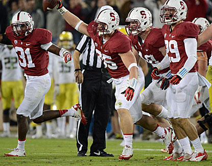 Jarek Lancaster celebrates recovering a fumble by Marcus Mariota. Stanford frustrates the Ducks QB most of the game. (USATSI)
