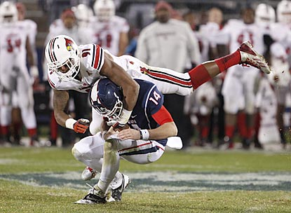 Louisville defensive end Marcus Smith sacks Connecticut's Tim Boyle in the second half.  (USATSI)