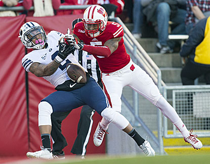 Wisconsin DB Darius Hillary breaks up a pass as the Badgers hold the powerful BYU offense in check in a 27-17 win. (USATSI)