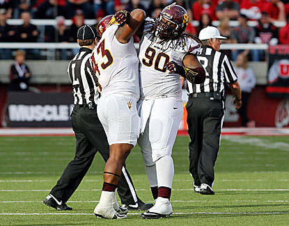 Arizona State DT Will Sutton snags a late interception to salt away the Sun Devils' win at Utah. (USATSI)