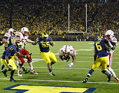Ameer Abdullah dives into the end zone with the winning score to send Nebraska past Michigan in Big Ten play. (USATSI)