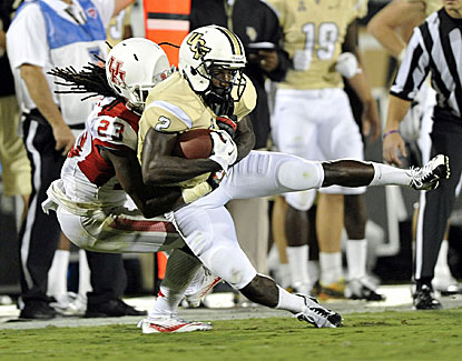 Trevon Stewart makes the tackle on UCF's Jeff Godfrey, but the Knights finish strong to retain first place in the AAC. (USATSI)
