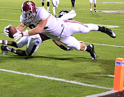 Alabama's Brian Vogler stretches for the goal line and a TD as the Crimson Tide stay perfect by beating Mississippi State. (USATSI)